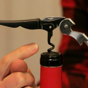 The Trick to Opening A Bottle Of Wine With A Waiter's Corkscrew